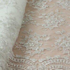 Сетка расшитая вручную бисером белого цвета с фестонами