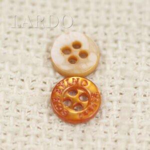Пуговица перламутр оранжевый ∅ 1,0 см