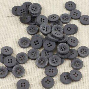 Пуговица пластик ∅ 1,5 см серого цвета