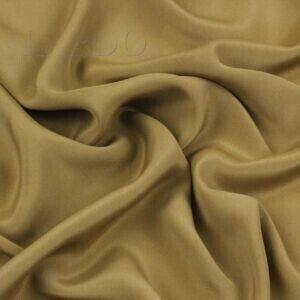 Крепдешин коричневая охра Италия Состав: шёлк 57 %, ацетат 43 % Плотность ≈ 75 г/м ² Ширина 142 см